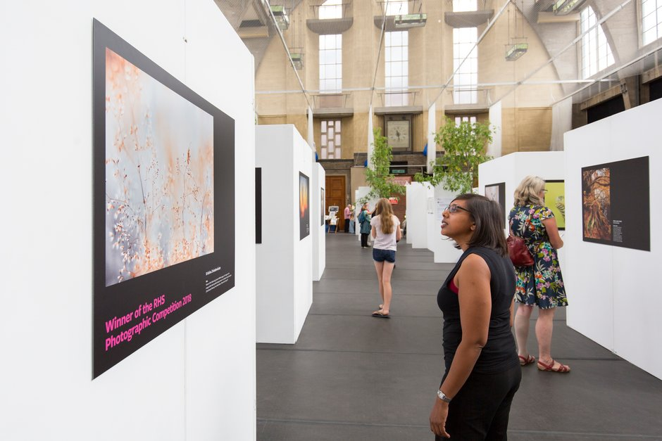 Visitors look at the 2018 RHS Photographic Competition display